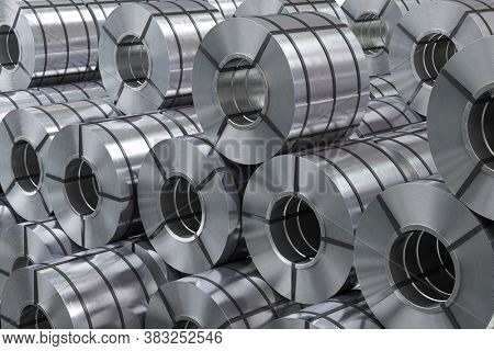 Rolls of metal sheet. Zync, aluminium or steel sheet rolls on warehouse in factory. 3d illustration