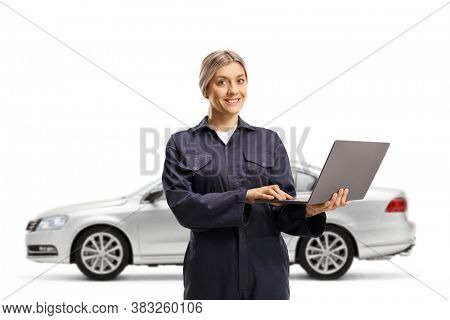 A silver car and a female auto mechanic worker in a uniform holding a laptop computer isolated on white background