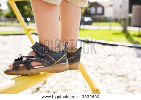 Child Feet In A Playground