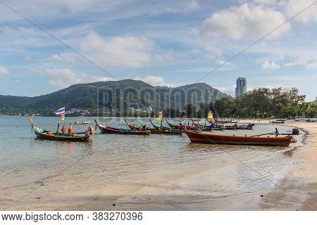 Phuket, Thailand - November 29, 2019: Traditional Longtail Boats On The Shore Of Patong Beach At And