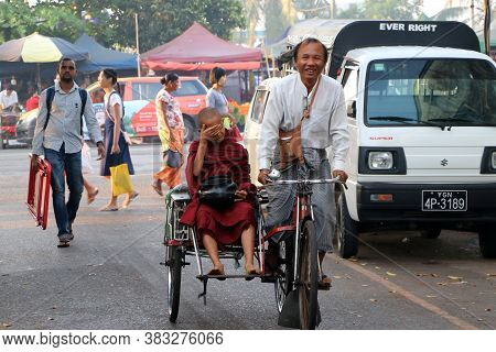 Yangon, Myanmar Feb 24, 2019: Myanmarese Neophyte Of Monk Sitting On The Bicycle Tricycle Taxi With