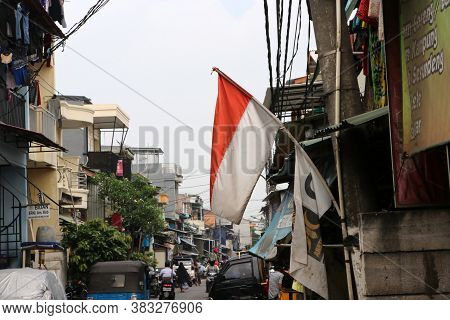 Jakarta, Indonesia May 6, 2019: Indonesian Flag On The Alleyway In Jakarta, Indonesia.