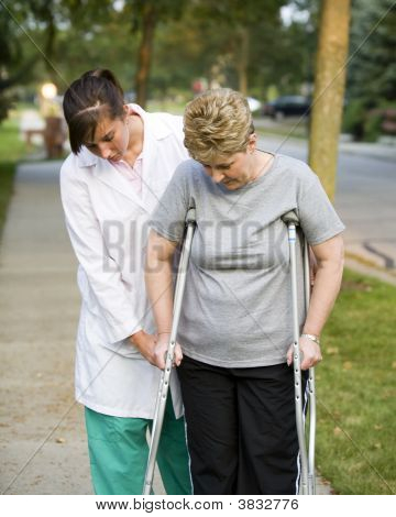 Helping A Woman On Crutches