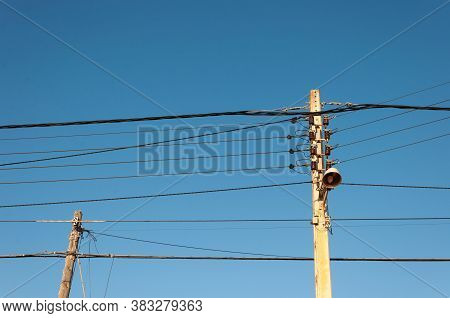 Two Old Light Wiring Poles With The Background Of The Blue Sky At Sunset