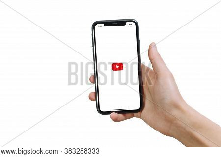 Samara Russia - 04.05.2020: A Man Holds An Iphone 11 In His Hand With The Youtube App On A White Iso