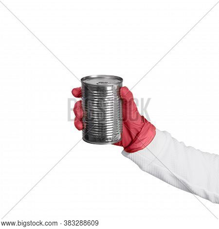 Female Hand In Red Disposable Gloves Holds Tin With Canned Food Or Preserves. Kitchen And Food Conce