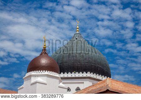 Dome At Masjid Kapitan Keling In Blue Sky.