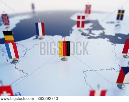 Flag Of Germany In Focus Among Other European Countries Flags. Europe Marked With Table Flags 3d Ren