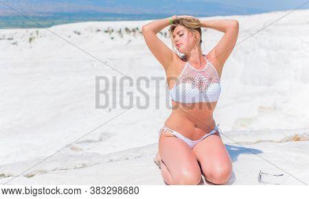 Nice European Woman Model With Perfect Figure Sunbathing In Swimsuit On Pamukkale Cotton Castle Trav