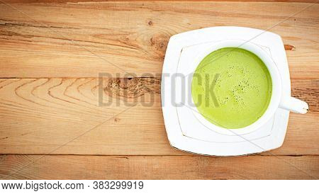 Japanese Matcha Green Tea Is Poured Into A White Mug And On A White Saucer In Powder. Tea Set On A T