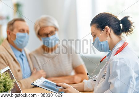 Doctor and senior couple wearing facemasks during coronavirus and flu outbreak. Virus protection, home quarantine. COVID-2019. Taking on masks.