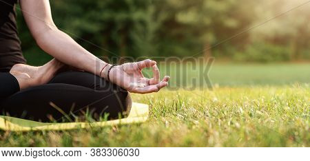 Close Up Of Young Woman Practicing Yoga In The Back Yard With Copy Space