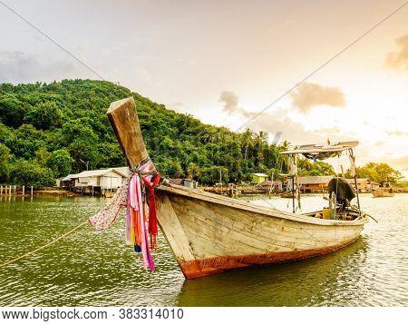 Traditional Thai long tail boat at a fishing village on Ko Yao Yai island