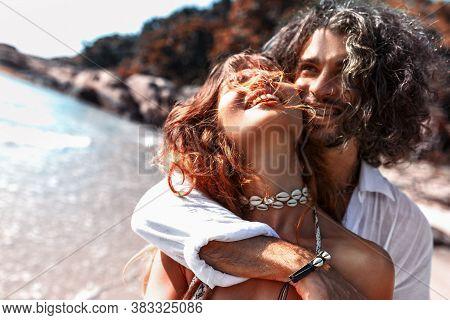 Beautiful Young Cheerful Couple Having Fun On The Beach