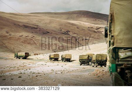 Ladakh Region. Military Truck Convoy On The High Mountain Leh - Manali Highway On Jammu And Kashmir,