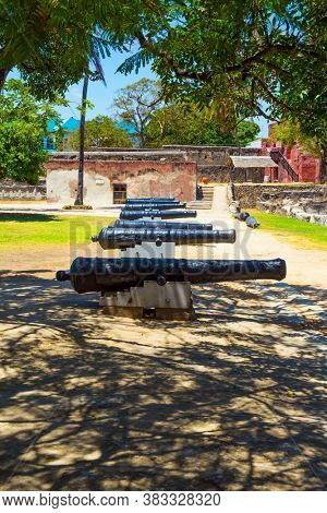 Guns are on display in the fortress. Fort Jesus -  medieval fortification in Mombasa, Kenya. The concept of historical, educational and photo tourism