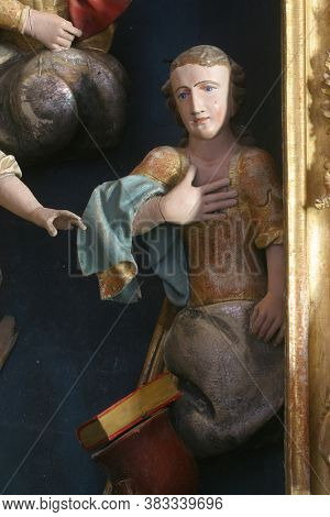 KRAPINA, CROATIA - JULY 01, 2013: Statue of Saint on the altar of Fourteen holy helpers in Church of Our Lady of Jerusalem at Trski Vrh in Krapina, Croatia