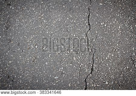 Smooth Surface Of Asphalt With A Crack In The Coating Close-up, Texture, Background