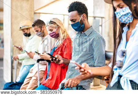 Multiracial Friends With Face Mask Using Tracking App With Mobile Smart Phones - Young Milenial Peop