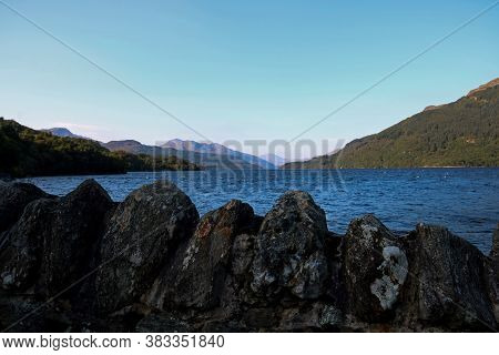 View Of Loch Lomond Scotland From A Scenic Viewpoint With Stone Wall