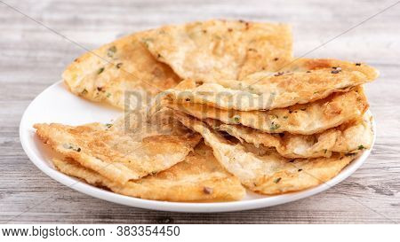 Taiwanese Food - Delicious Flaky Scallion Pie Pancakes On Bright Wooden Table Background, Traditiona