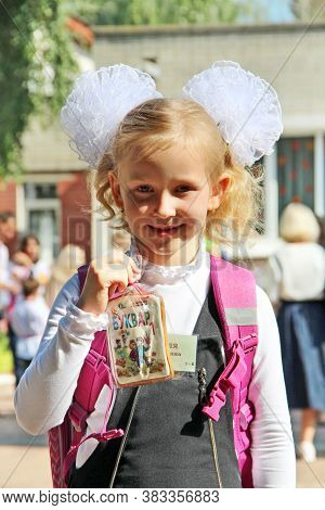 Chernihiv / Ukraine. 01 September 2020: First Grader Girl Goes To School The First Time In Life. Sch