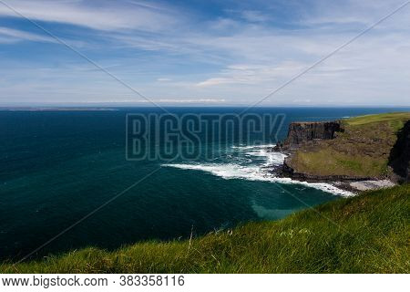 Photo Capture Of A Breathtaking Natural Nature Landscape. Cliffs Of Moher With Aran Islands View, Wi