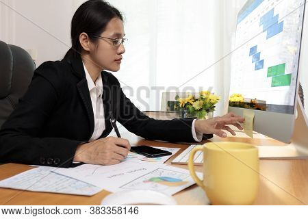 Business Woman Working In Office Looking And Check Paper Note. Business People Analysis Scheduler Da