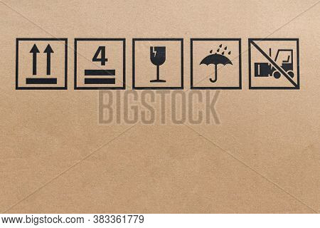 Black Fragile Sign Icons On Cardboard. Package Box With Symbol Indicating Fragile Item, Need Careful