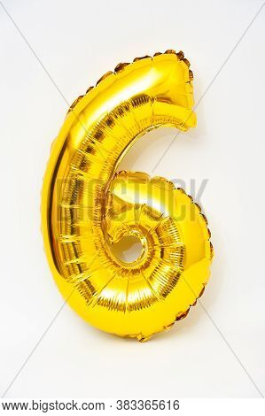 Inflatable Numeral 6 Sparkling Metallic Golden Color Isolated On White Background. Close-up. Vertica