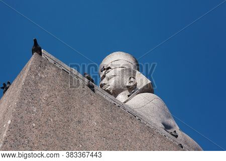 Ancient Egyptian Sphinx Monument, View From Below, Pigeons Sitting On The Statue
