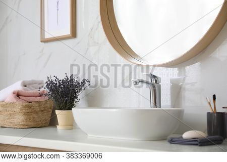 Bathroom Counter With Vessel Sink, Flowers And Towels In Bathroom Interior. Idea For Design