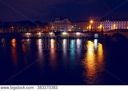 Paris And Seine Riverside In The Night . Pont Du Carrousel Illuminated In The Night