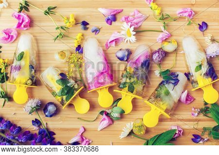 Floral Ice Pops Flat Lay. Colorful Wildflowers In Frozen Popsicles And Ice Cubes And Fresh Summer Fl