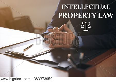 Intellectual Property Law. Jurist At Table In Office, Closeup