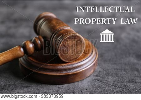 Text Intellectual Property Law Near Judge's Gavel On Grey Background