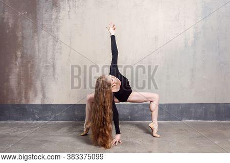 Beautiful Young Adult Long Haired Woman Dancing In Studio