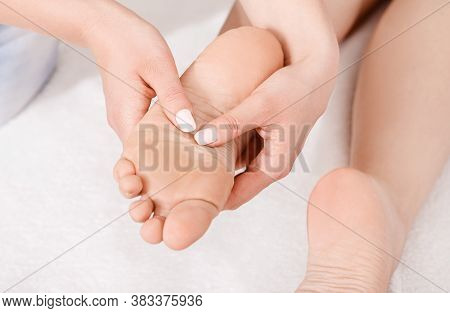 Acupressure Of Foot. Professional Doing Massage On White Background, Close Up, Free Space