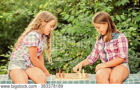 Sport And Hobby Concept. Little Girls Play Chess. Sisters Playing Chess. Smart Children. Early Child