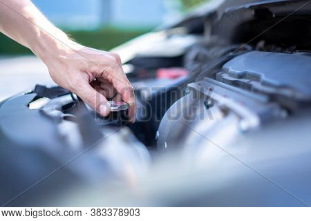 Man Hand Checking Level Of Coolant Car Engine. Check And Maintenance The Coolant In Car With Yoursel