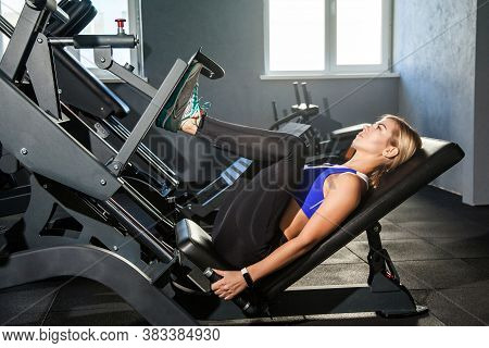 Bodybuilding Woman Lie On Simulator Platform