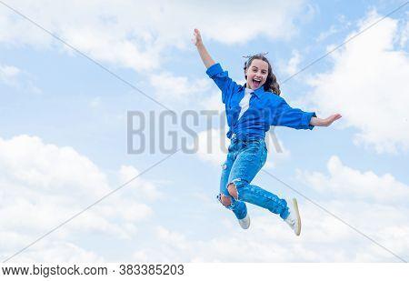 Cheerful Teen Girl Jumping High. Kid Jump Outdoor. Kid Fashion And Beauty. Sense Of Freedom. Portrai