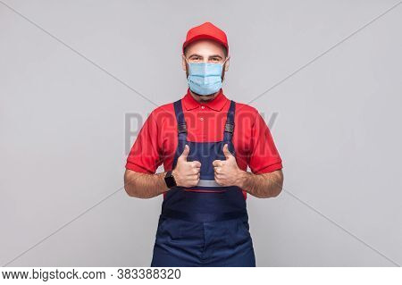 Work Are Done! Portrait Of Young Man With Surgical Medical Mask In Blue Overall, Red T-shirt , Cap,