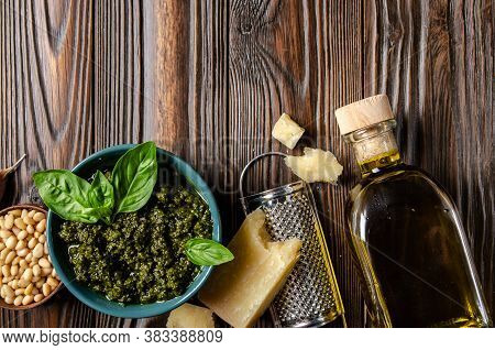 Flat Lay Food Background Of Genovese Pesto Sauce And Its Ingredients On Wooden Kitchen Table With Co