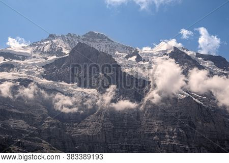 Clouds Surrounding The Flanks Of The Majestic And Famous Snow Capped Peak Of The Jungfrau And Its Sa