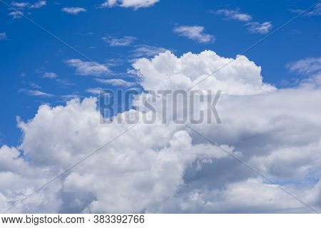 Sunny Clear Blue Sky Background With Beautiful Puffy Fluffy Clouds & Soft White Cloudscape In Tropic