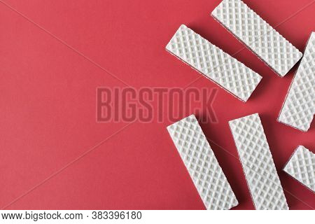 A Few Waffles With Chocolate On An Red Background. Selective Focus