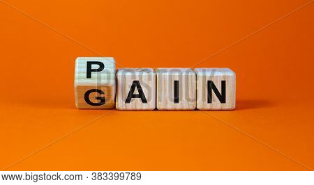 Flipping Wooden Cubes For Change Wording Between Pain To Gain. Mindset For Career Growth Business. B