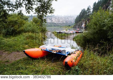 Sports Catamaran For Rafting On Mountain Rivers, Hiking Equipment, Inflatable Catamaran Stands On Th