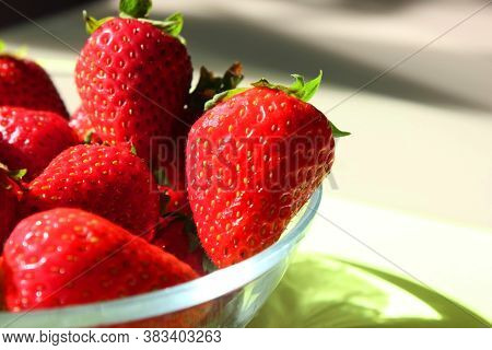 Fresh Ripe Delicious Strawberries In A Glass Plate On The Table.pile Of Red Strawberries On A Plate
